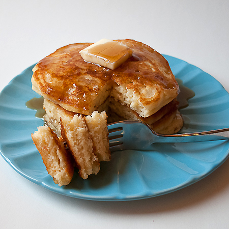 Fluffy buttermilk pancakes real mom kitchen picture of stack and bite of fluffy buttermilk pancakes ccuart Gallery